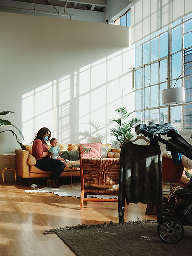 large window, baby, stroller, gold couch, chill loft,