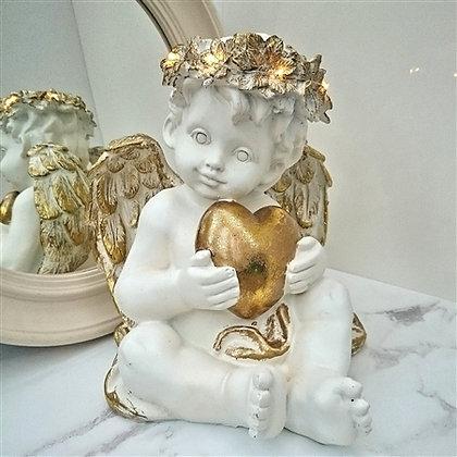 Sitting Cherub holding Gold heart