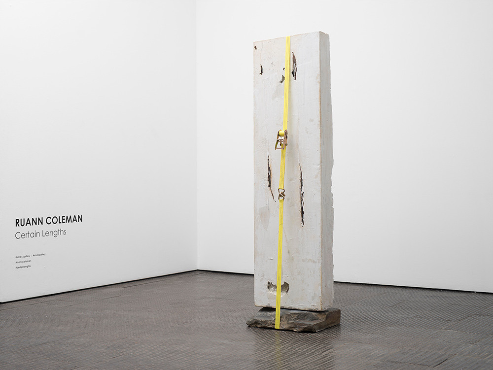 Ruann Coleman   Wound   2017   Plaster of Paris, Marble Hydrate, Strap, Found Stone and Branches   184 x 53 x 47 cm