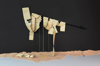 Simphiwe Buthelezi | Rapid expansion | 2020 | Wood, Straw Mats, Glass Beads and Oxidised Metal | Size Variable