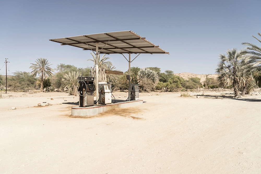 Margaret Courtney-Clarke | 'The Petrol Pump', Sesfontein, 27 October 2017 | 2017 | Giclée Print on Hahnemühle Photo Rag Paper | 74.5 x 112 cm | Edition of 6 + 2 AP