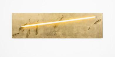 Pierre Vermeulen   Sweat print no. 1, light panel   2018   Sweat, Gold Leaf Imitate, Shellac and Light Bulb on Aluminium   50 x 180 cm