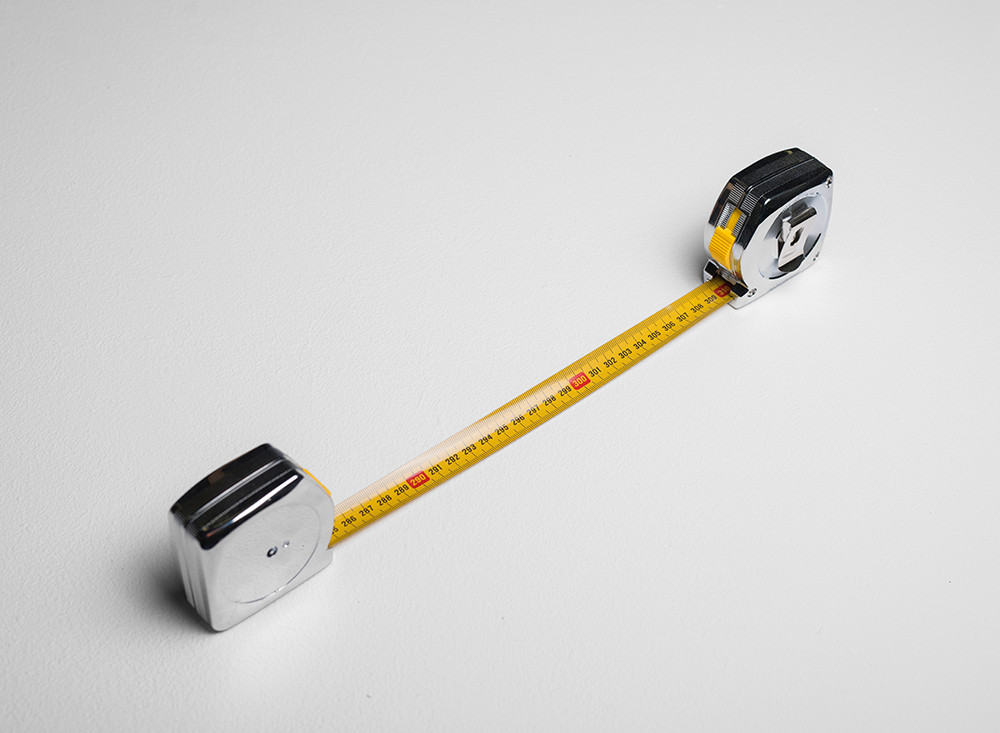 Ruann Coleman   The Distance Between Us   2017   Connected Measuring Tapes   7 x 38 x 3 cm