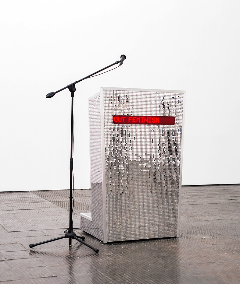 Marinella Senatore | Feminist Podium | 2019 | Led light, Mirror Tiles, PA System, Aluminum and Wood | 136 x 84 x 71 cm | Edition of 3