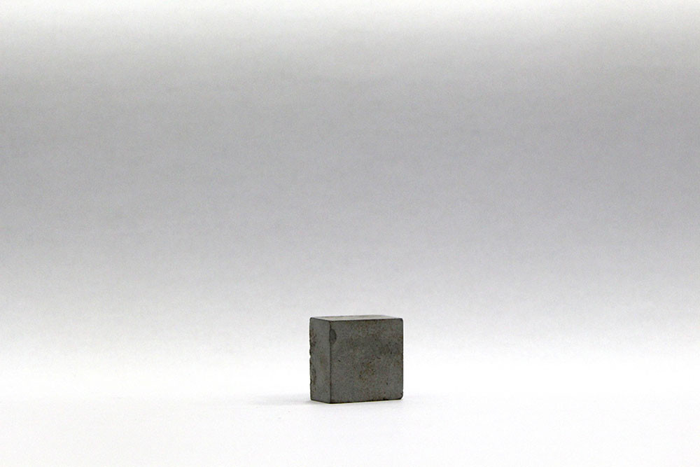 Ruann Coleman | Strength | 2013 | Steel Powder, Cement, Artists Tears | 1 x 2 x 2 cm