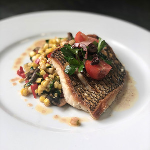 Black Bass over corn sautee, tomato & olives - 76 House