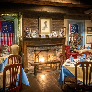 one of our four dining rooms & fireplace