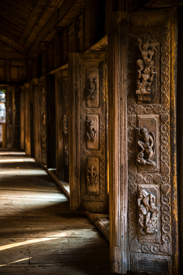 Hindu gods carved onto old Indian wooden pillars