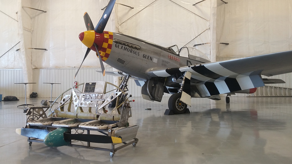 p-51 Mustang inside Telluride hangar next to aviation bench i built for show oct 3 2016