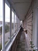 Холодное алюминиевое остекление раздвижными рамами 11-метровой лоджии в Красноярске