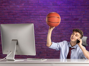 front-view-office-worker-office-desk-holding-basketball-talking-phone.jpg