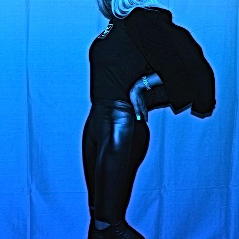 confident Woman Pose. Wearing black tee