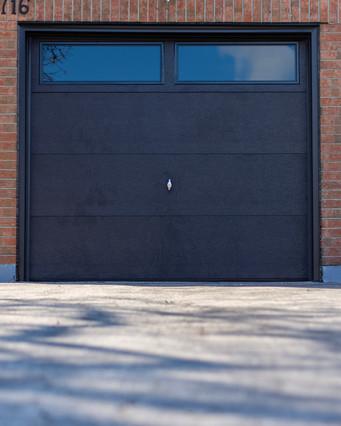 Flush panel Black Insulated tinted windows 8' x 7'  Black aluminum capping
