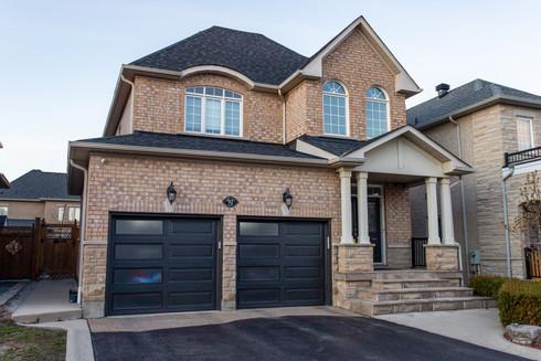 Long raised panel Dark brown Frosted plexiglass windows 8' x 7' Dark brown aluminum capping