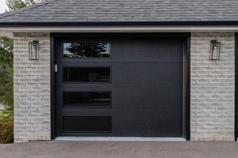 Flush panel Black Insulated tinted windows 9' x 7' Black aluminum capping