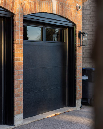 Flush panel Black Insulated tinted windows 8' x 7' Black aluminum capping (arched)