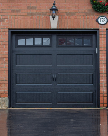Carriage house ; Long panel Black Clear plexiglass windows Arched Stockton inserts 8' x 7'  Black aluminum capping Standard hardware