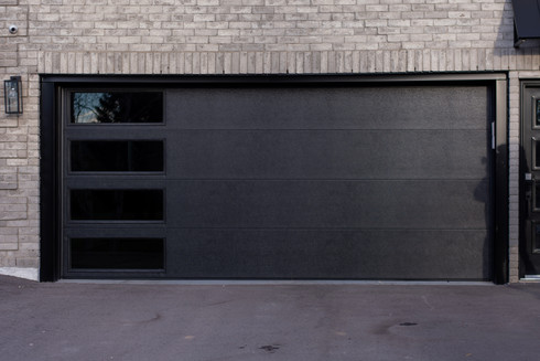 "Flush panel Black Insulated tinted windows Custom 16'6"" x 7'  Black aluminum capping"