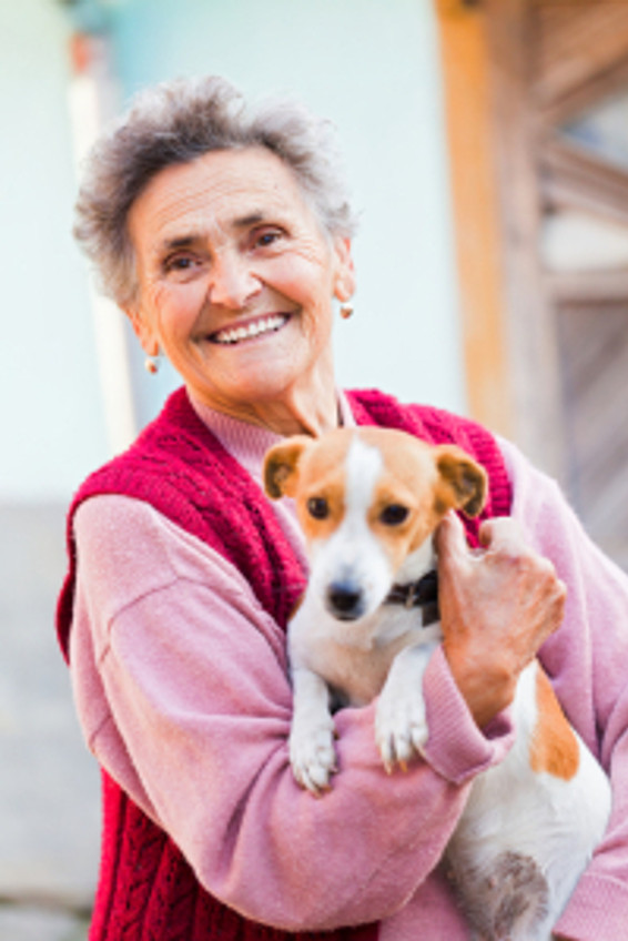elderly woman holding dog