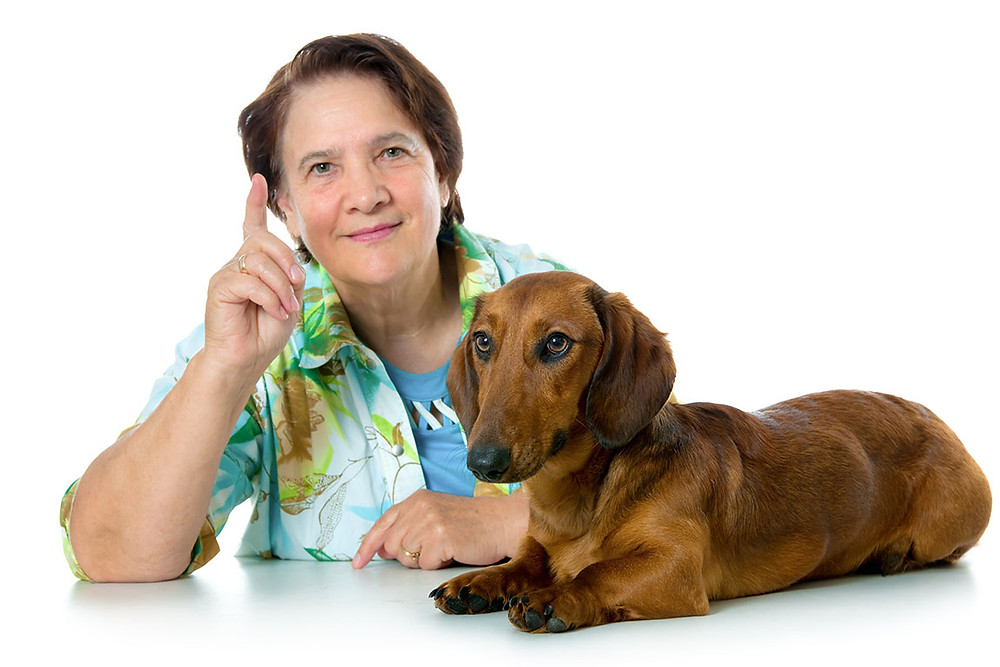 woman with dog giving advice