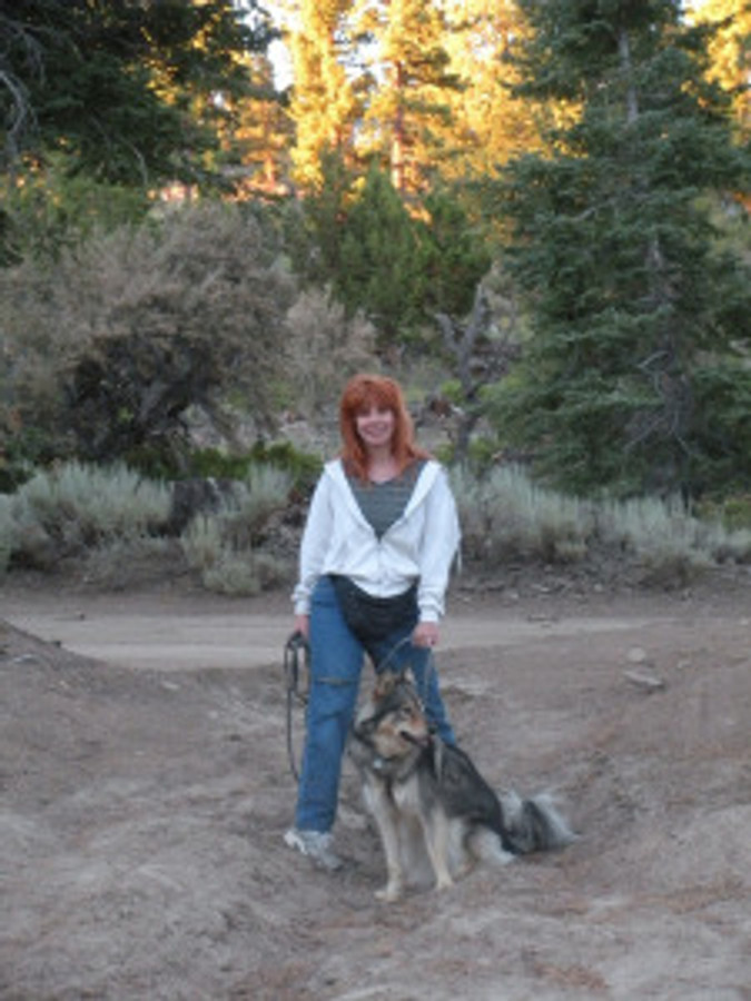 woman with dog in nature