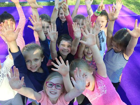 hands up happy kids.jpeg