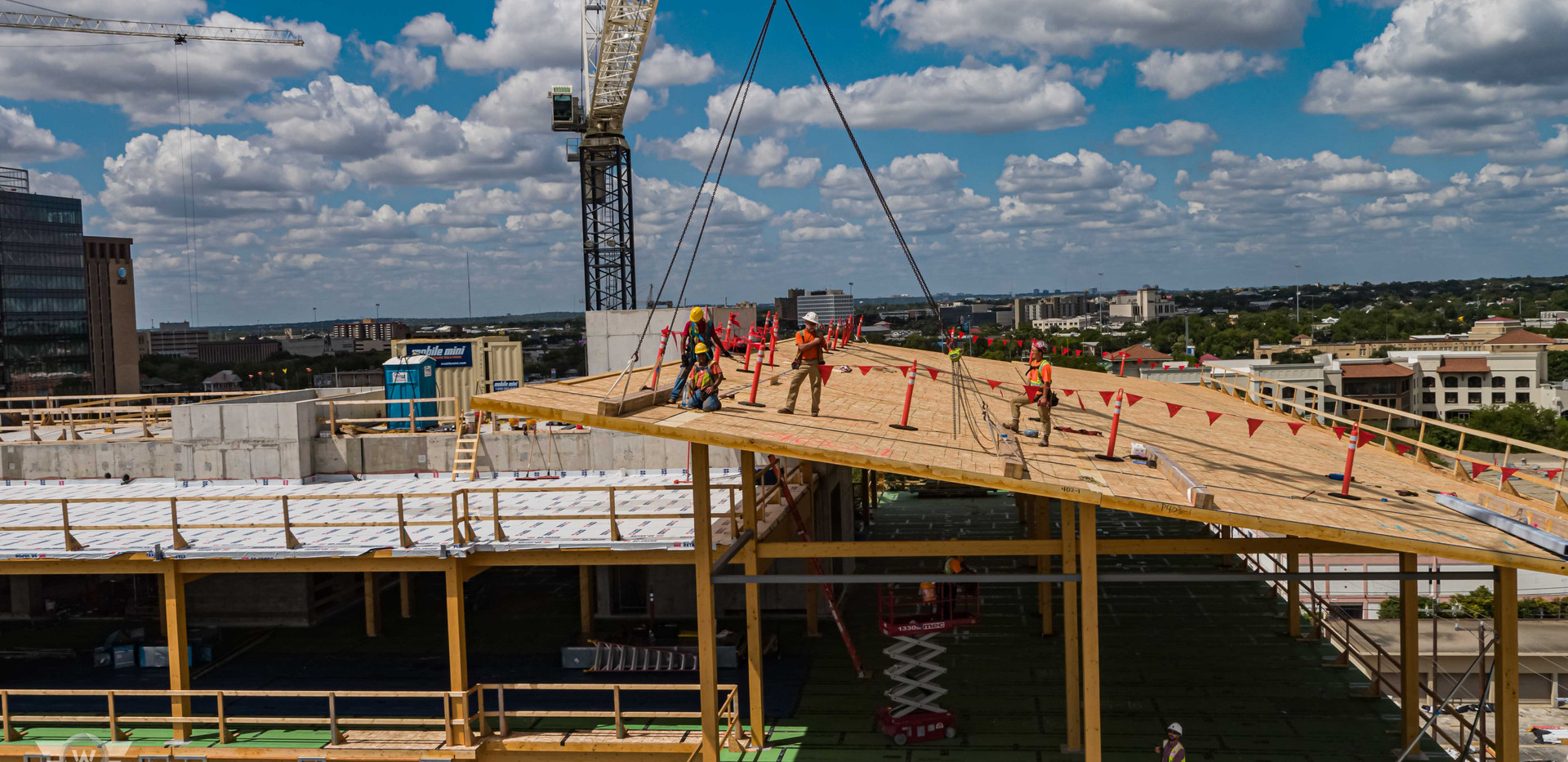 Drone photo of construction workers on top of The Soto construction - White Cloud Drones.jpg