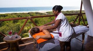 Profitez de vos vacances pour vous détendre. Et quoi de mieux qu'un massage face à la mer?