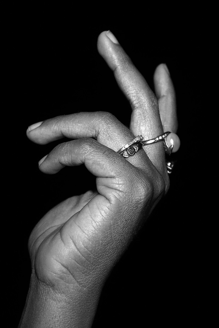 1: The hand who had a story  This image depicts the subject's hand on regular day. The hand is in a relaxed 'come here' hand signal. This signal is telling the viewer to come over to here and listen to her story.