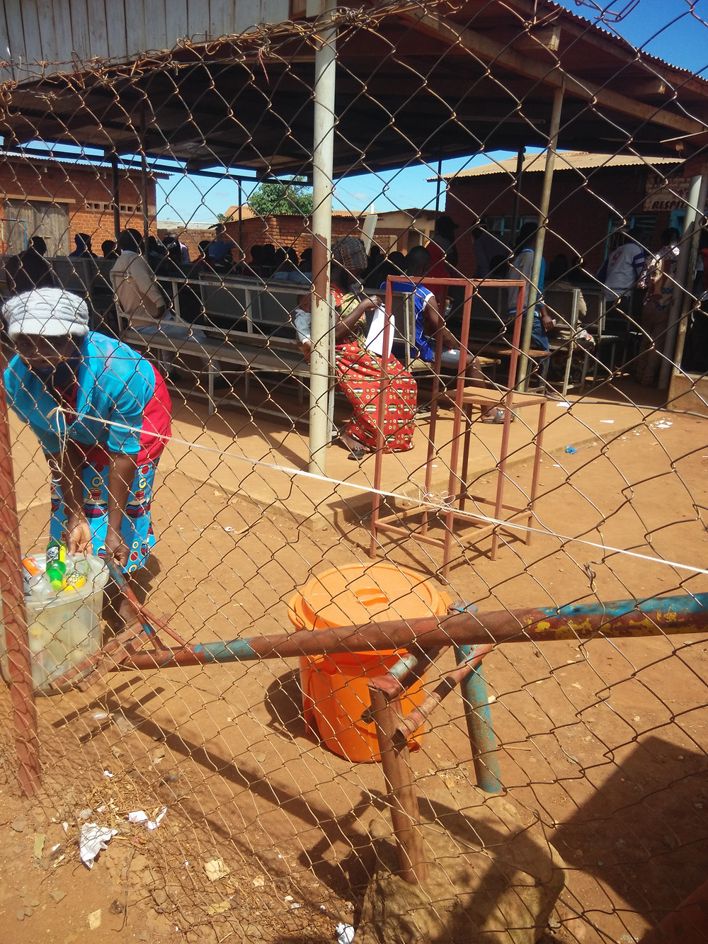 Refugees receive a sum of money from MyBucks banking corporation in Dzaleka