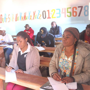 Young people learn English and French as their second languages at Dzaleka Refugee camp