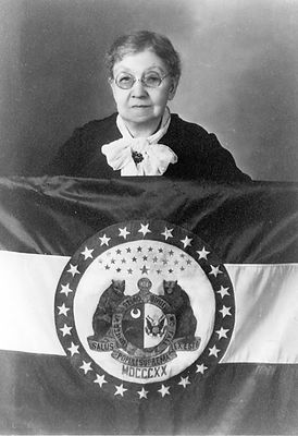 Major events page lady with MO flag.jpg