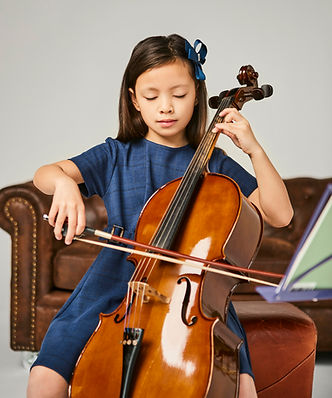 young-girl-learning-how-play-cello-home.jpeg