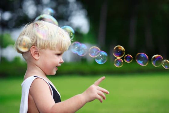 canva-little-boy-pointing-at-bubbles-MAD