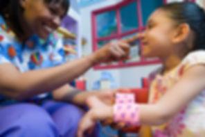 Nurse caring for girl.jpg