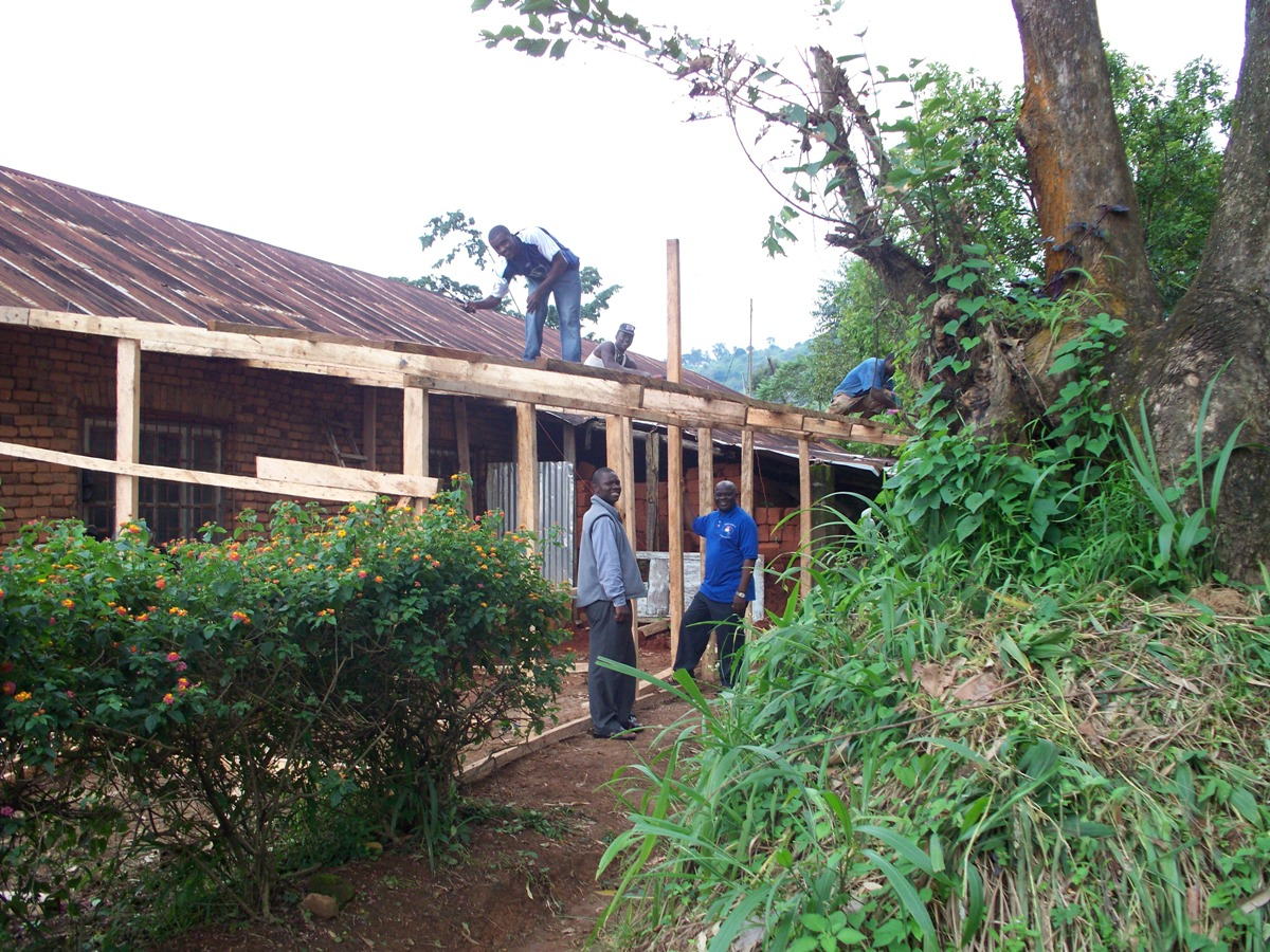 Fr. Ateh supervising the construction of the house