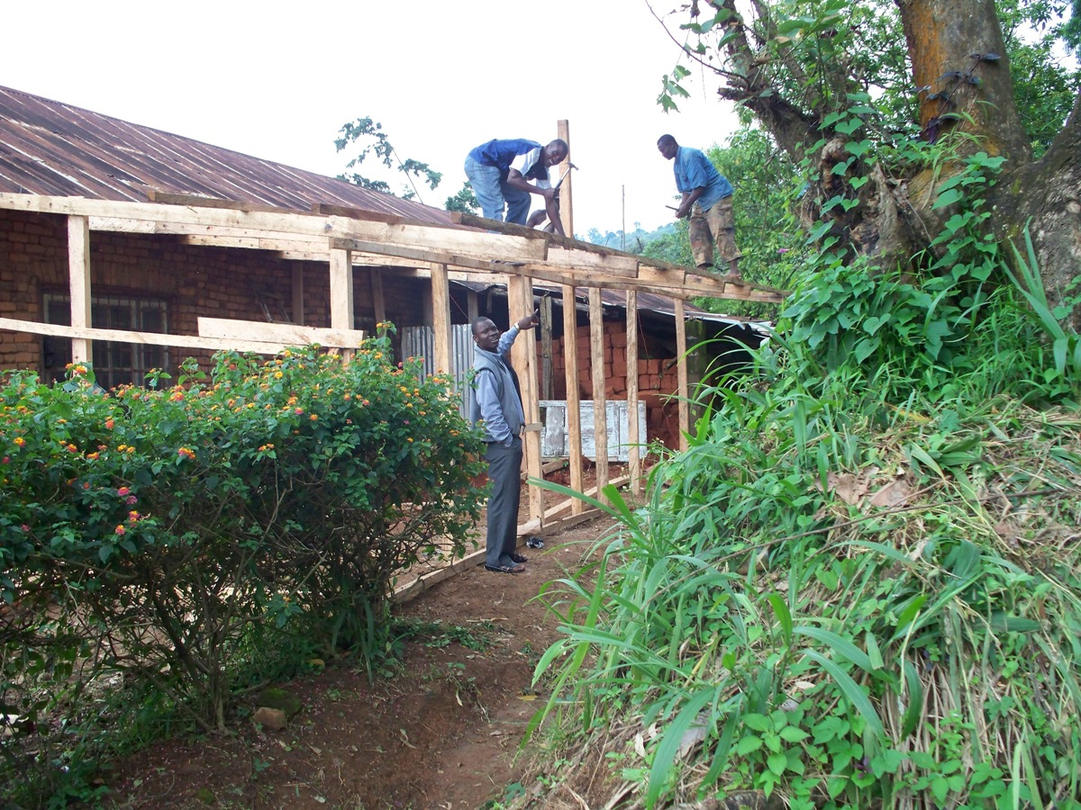Carpenters constructing the farm house