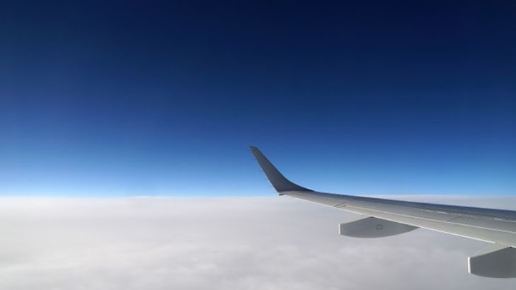view-airliner-wing-from-window_395237-10