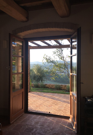 Doors onto the terrace above the pool