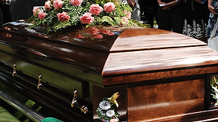 Coffin on a grave 1.png