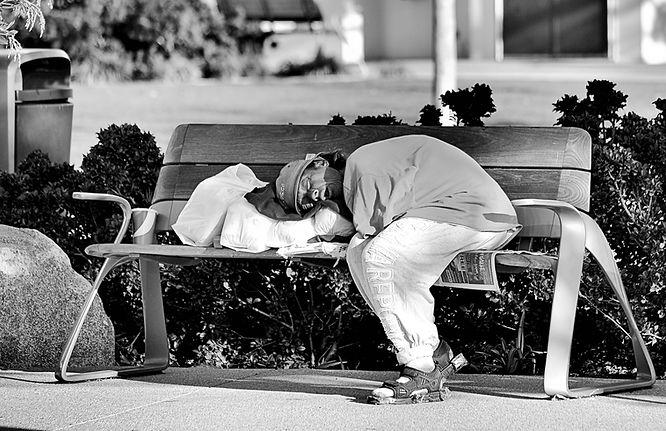 SLEEPING MAN AT SEAPORT VILLAGE.jpg