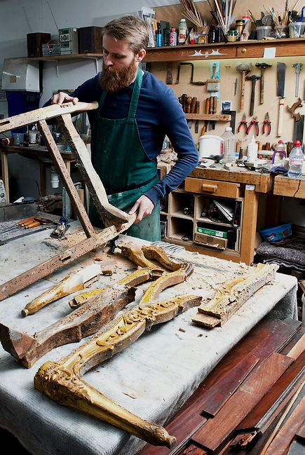 Philip Burrows restoring an antique gilt chair.