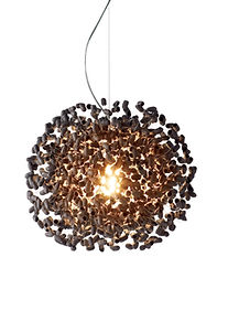 Silk cocoon in black ceiling light