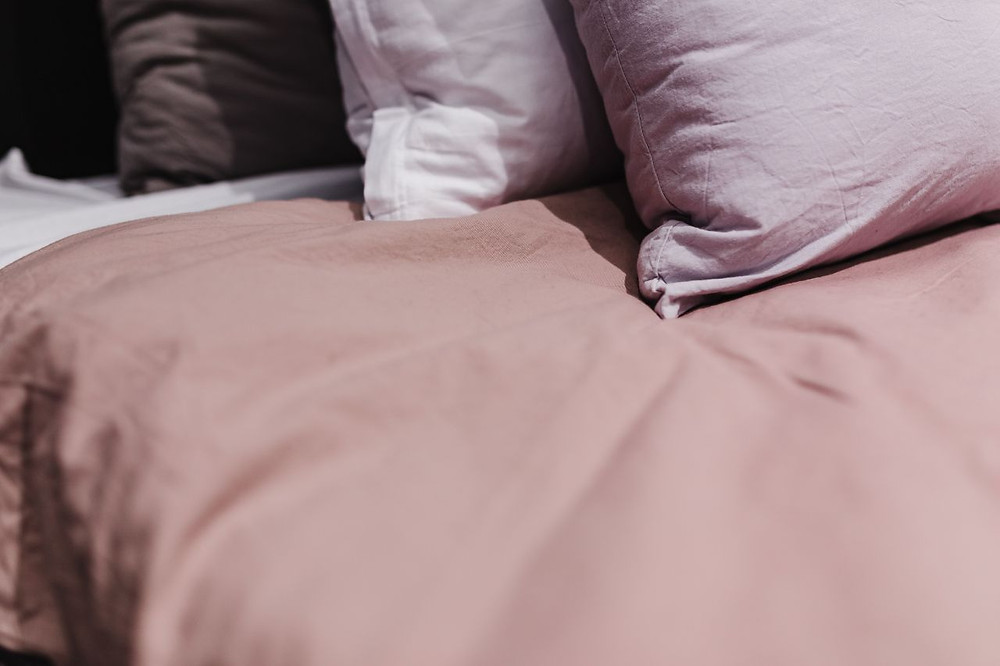 Bed with bedding and pillows