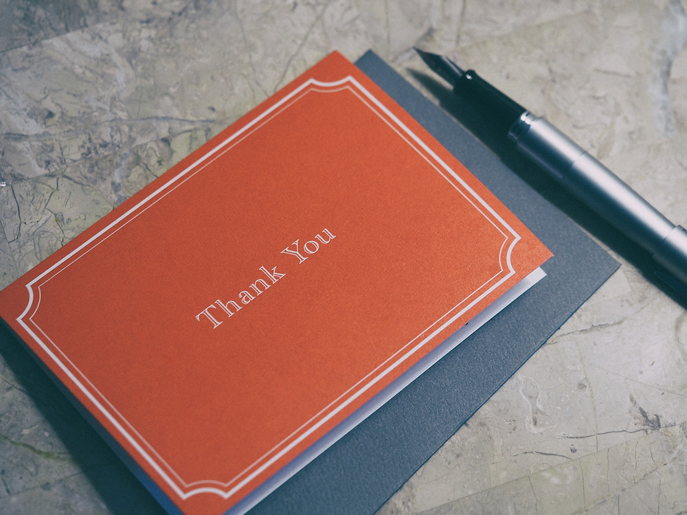 Thank you note with a pen.