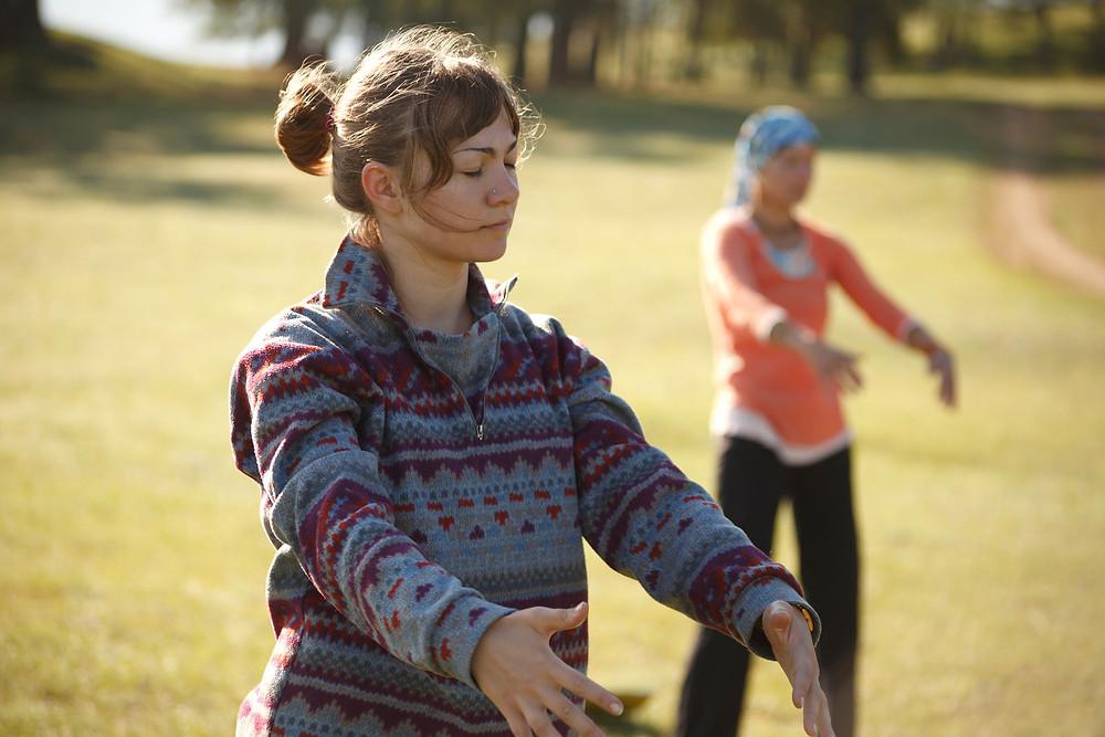 Women practicing Qi Gong