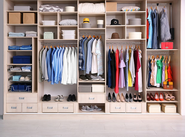Big wardrobe with different clothes for