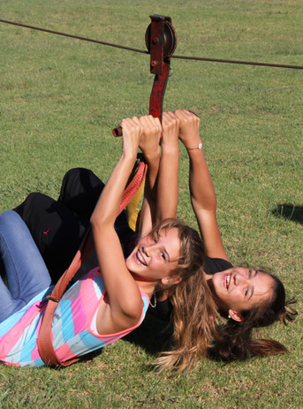 Girls going down the zipline