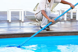 Pool cleaner during his work. Hand afric