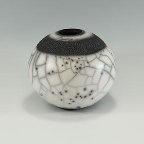 Naked raku sphere with impressed decoration